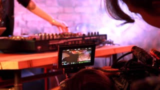 Backstage of Filming a Party. Real backstage of filming a girl dj performing on a party. Great for presenting your film courses