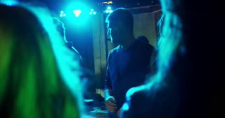 Dancing in a Nightclub. Young people dancing in the nightclub. They are friends, celebrating Birthday party, or a New Year
