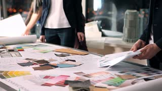 Designers at Work. A group of young designers led by the head are working on the project of design business center, private home, studio, shop, office.