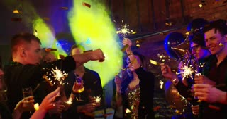 Happy New Year. Young people are firing bengal lights at a nightclub. They are celebrating New Year and Christmas