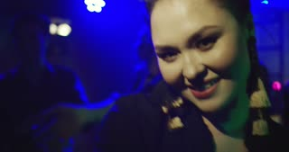 Selfie Time at a Nightclub Asian young woman taking selfie while dancing. Slow motion. She's happy and cheerful