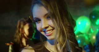 Selfie Time at a Nightclub. Young woman taking selfie while dancing. Slow motion. She's happy and cheerful