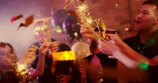 Sparkling Bengal Lights. Young people are firing bengal lights at a nightclub. They are celebrating New Year and Christmas