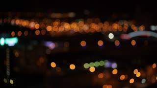 View of the City at Night from the Roof of a Skyscraper/Bokeh timelapse of the city view from the roof of a skyscraper