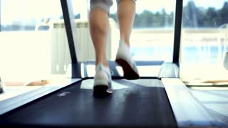 Woman Running on a Treadmill, Close-Up Shot