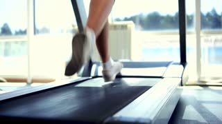 Woman Running on a Treadmill, Dolly Close-Up Shot