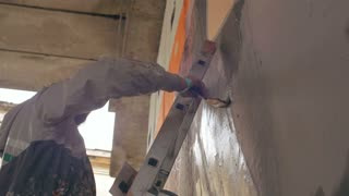 graffiti artist painting on the wall