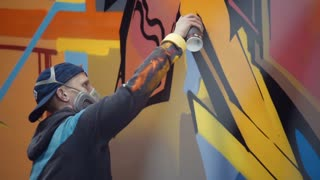 Graffiti painting on the wall, interior, slow motion