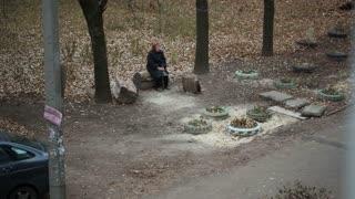 Alone Elderly Women Sitting On A bench
