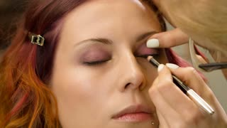 Applying make up pencil For Woman