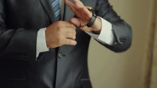Businessman Putting on a Watch