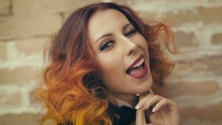 Cheerful Redhead woman blinking