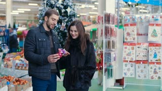 Couple buying Christmas tree toy