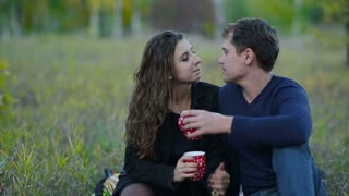 Couple Drink Tea in a Park