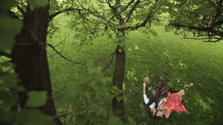 Couple in Love Lies Under the Tree