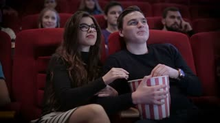 Couple waching a movie at cinema