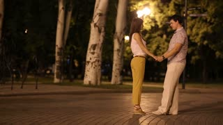 Couple walking at Night city