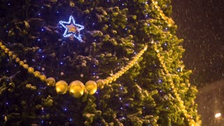 Decoration on Christmass tree at evening city