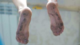 Dirty feet of a man