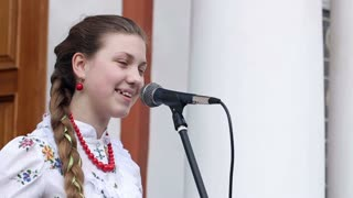 DONETSK, UKRAINE- 06 April 2015: girl singing folk songs
