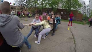 DONETSK, UKRAINE- 06 April 2015: happy children pull rope