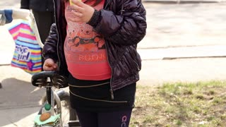 DONETSK, UKRAINE- 06 April 2015: obese girl eats cookies and drinking tea