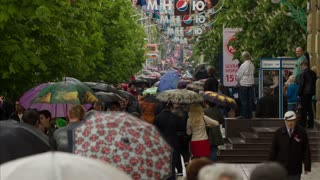 DONETSK, UKRAINE- 09 May 2015: people with umbrellas walk under the rain