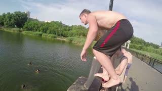 DONETSK, UKRAINE- 1 June 2015 :Man jumps from bridge to river