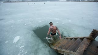 DONETSK, UKRAINE-JANUARY 19: Man swimming in a ice-hole. Orthodox tradition