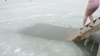 DONETSK, UKRAINE-JANUARY 19: Woman swimming in a ice-hole. Orthodox tradition