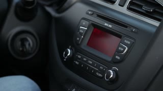Driver Tuning Radio In Car