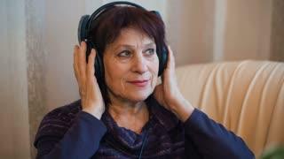 Elderly woman in Headphones