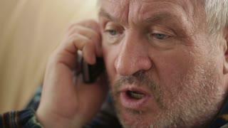 Eldery man speaking on the phone