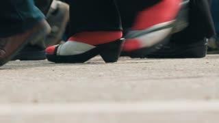 Feet of walking people