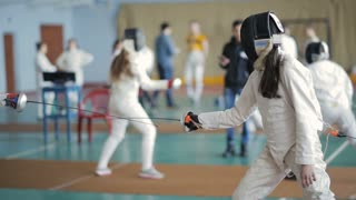 fencers women on a training