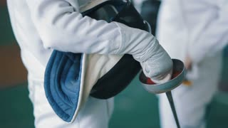 fencing mask and foil in a hands of fencer