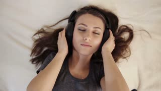 Girl in Love Listening Music in Bed