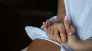 Hands With Ring on a Lap