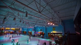 Ice Rink. People skating on ice