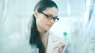 Laboratory worker checking the contents of flask
