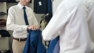 man tries on a suit