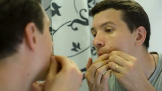 Man with Problem Skin queezing pimples