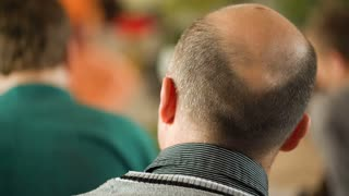 Old man's balding grey head