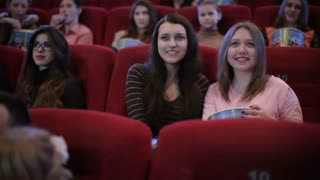 people watching comedy movie in cinema