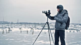 photographer with tripod in winter