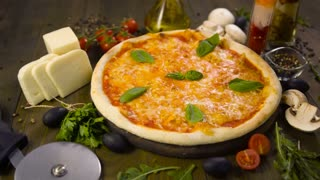 Pizza with mozzarella, cheese and basil leaves
