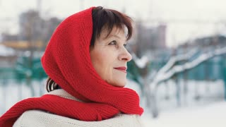 Portrait of eldery woman at winter