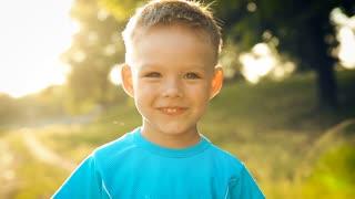 Portrait of smiling boy on sunset