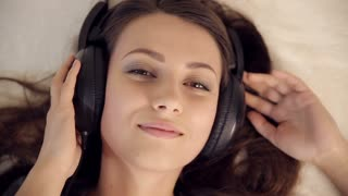 Pretty Girl in Love Listening Music in Bed