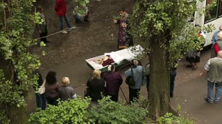 Priest Says a Prayer Over the Dead